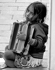Gipsy (vittorio vida) Tags: poverty street portrait people girl children eyes sarajevo bosnia accordion gipsy