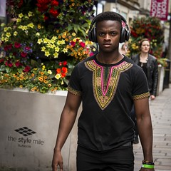 Feel The Beat (Leanne Boulton) Tags: outdoor people urban street candid portrait portraiture streetphotography candidstreetphotography candidportrait eyecontact candideyecontact streetlife man male face facial expression eyes look emotion feeling anger stare juxtaposition style stylish colourful colorful flowers headphones tone texture detail depth natural light shade shadow city scene human life living humanity society culture fashion canon 7d 50mm color colour square crop format glasgow scotland uk
