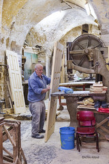 Carpenter (Achille Abboud) Tags: industry carpenter schreiner beruf handwerk wood old city nazareth hope happy tradition machine doors profession proffession