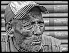Elderly Khasi man watches Saturday morning traffic in Shillong (stevebfotos) Tags: meghalaya shillong elderly bw man topaz india in