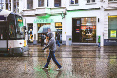 Walking in the rain (marcducati) Tags: rain rainy raining umbrella paraplu canon 35mm canon35mmf20 35mmf20 6d canon6d f20 ghent gent summer walking waterdrops architecture water regen outdoor buiten zomer male femal tramway electrictramway electricvehicle kasseien cobblestones apotheek pharmacy clearumbrella raindrops raindrop jacket wet slippery slipperywhenwet people peoplewalking
