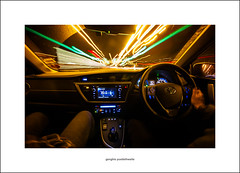 Busy night, tonight (Descended from Ding the Devil) Tags: 2014 canon40d february lightroom sigma1020 afterdark driving lighttrails night photoborder tripod a38