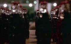 Coke (Minchioletta) Tags: pentaxmesuper smcpentaxa50mm smcpentaxa50mmf17 50mmlens fujisuperia400 fujisuperiaxtra400 c41 lomographyandvintagecameras analogicait bokeh sfocato bottle bottiglia coke cocacola