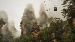 Cable Car Climbing up Zhiangjiajie - Hunan - China (Rogg4n) Tags: china canoneos100d iconic hills nature zhangjiajie nationalpark avatar pandora hunan peak summit forest mountains landscape travel asia panorama  rock efs18135mmf3556isstm sky clouds peaks pine   mist rain fog misty pluie cablecar tlphrique