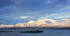 the very shades of Icelandic winter (lunaryuna) Tags: winter sky panorama sunlight snow mountains ice water season landscape iceland lowlight mood colours atmosphere fjord lunaryuna isle theenchantmentofseasons hvalfjoerdur