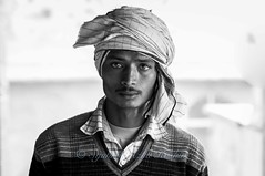 A guardian... (Syahrel Azha Hashim) Tags: travel light vacation portrait people bw india holiday detail male prime blackwhite nikon dof getaway indian details culture 85mm naturallight portraiture handheld local shallow simple traditionalclothing pc9 nikkoraf85mm d300s syahrel baswa