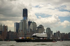 The space shuttle Enterprise is towed by barge up the Hudson River in New York (June 6, 2012) (manhhai) Tags: newyorkcity usa ny newyork worldtradecenter enterprise spaceshuttle freedomtower ov101