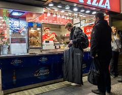 Pizza Guy (UrbanphotoZ) Tags: nyc newyorkcity ny newyork subway lights manhattan pizza midtown corona pretzels tips macys vendor westside budlight budweiser foodcourt pennstation customers bystander suiter