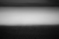 Dark Shores (www.paulshearsphotography.com) Tags: uk longexposure sea england blackandwhite bw seascape water monochrome sunrise 35mm dark grey dawn iso100 coast blackwhite surf unitedkingdom stones pebble