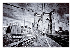 Brooklyn Bridge B/W (Daniel Szymanek) Tags: new york nyc bridge light sea vacation blackandwhite bw panorama usa cloud white holiday beach nature brooklyn clouds digital america creek canon wonder flow photography eos photo wasser soft exposure flickr colours time bokeh united picture wave full timeexposure filter frame 5d sw 28 states fullframe bild welle farben verwischt mkii langzeitbelichtung mark2 weis langzeit 1635mm weich schwarzweis 1635mmf28 canonef1635mmf28lusm 1635mm28 canoneos5dmark2