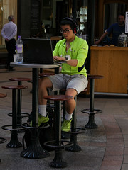 Keeping cool (paul indigo) Tags: paulindigo cafeteria earphones fan green laptop man people portrait shoppingmall streetphotography