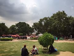 Loveship, Friendship (Mayank Austen Soofi) Tags: delhi walla sky cloud monsoon lovers friends ear cleaner garden connaught place tree
