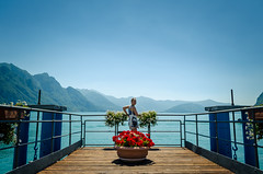 Mountain View // Riva di Solto (//Sebastian) Tags: lombardy italy lagodiseo rivadisolto mountains lake water blue castro red brown sailor flower sky jetty footbridge plank harbor line monteisola