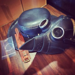 Packing orders is always fun :(. - [x] #postapocalyptic #postapocalypse #steampunk #steampunkmask #leathermask #handmade #LARP #plaguedoctor #plaguedoctormask #dieselpunk #dark #Leather #costume #cosplay #tophat #leatherhat #haloween #haloweencostume (tovlade) Tags: face mask cyberpunk cyber goth make up goggles girl punk postapocalyptic postapocalypse black steampunk leather hand made larp cybergoth dieselpunk plague doctor