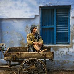 Waiting (Dick Verton ( more than 13.000.000 visitors )) Tags: travel blue people india man waiting asia sitting sit varanasi seated bluewall travelphotographer dickverton