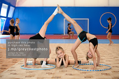 Gymnastic composition made by three girls (creativemarket.photo) Tags: people girl smile up sport horizontal female composition train pose happy person kid child floor exercise leg group young stretch teen gymnast gymnastics teenager practice cheerful athlete workout gym graceful hulahoop position sportsman sporty skill practise flexible   sportive sportswoman  legsplit