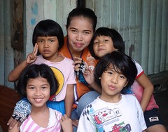 motorcycle taxi driver and her daughters (the foreign photographer - ) Tags: woman female portraits children thailand bangkok taxi sony daughters motorcycle driver khlong bangkhen thanon rx100 dscjan242014sony