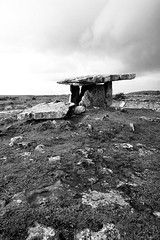 Poulnabrone (Peter Gutierrez) Tags: photo europe european europeans ireland eire irish iveragh burren clare claire poulnabrone poll na mbrón stone ring prehistoric ancient stones rocks rock rocky heritage portal tomb menhir menhirs dolmen dolmens pierre pierres standing megalith megaliths megalithic mégalithique mégalithe mégalithes néolithique neolithic boulder boulders field fields black white bw peter gutierrez petergutierrez film photograph photography