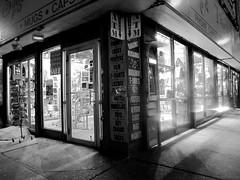 Ode to Trinket Shops (frankieleon) Tags: street new york city nyc newyorkcity light blackandwhite bw white ny black night corner junk downtown glow shine darkness manhattan tourist midtown souvenir crap area buy nightlife atm purchase ripoff souvenirshop cornerstore trinket overpriced bargin crapforsale trinketshops