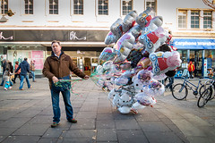 Balloon Seller F (The Image Den) Tags: portrait balloons bored streetphotography windy streettrader vendor southampton towncentre abovebar fedup