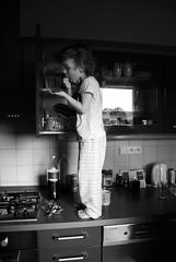 Inflagranti (kobianda) Tags: bw kitchen blackwhite funny child inflagranti steelingchocolate