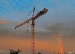 Over the rainbow (Jean S..) Tags: crane sky rainbow red colors clouds summer blue orange