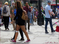 `1726 (roll the dice) Tags: london westminster westend oxfordstreet injured sexy pretty girl next people natural streetphotography sad mad funny stare look reaction bandage londonist uk art classic urban unaware unknown sale bargain shopping fashion england portrait strangers timing candid bag limp transport travel mark legs thigh couple pain skirt fun society