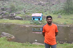 Reni poses against the duck farm (oldandsolo) Tags: kerala india godsowncountry vagamon vagamonhills idukkidistrict hillscenery nature photography takingpictures agriculture teacultivation teabushes teaestate teagarden pond lake scenic hut tourguide