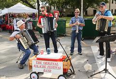 Playing Music and Having Fun (wyojones) Tags: texas caldwell kolachefestival czech music originalkolachefestivalband horns trumpets cornets accordians sueezebox musicians wagon sign guys men boys sunglasses shades smiles enjoyment fun