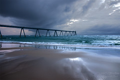 Wharf and storm reflections ((Virginie Le Carr)) Tags: ocean sky cloud storm reflection landscape sand sable atlantic ciel wharf nuage paysage reflets orage atlantique ocan lasalie