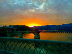 Golden Sunset - Edit 2 (Roland 22) Tags: blue sunset sky orange white reflection green water yellow clouds golden evening twilight glow dusk tennessee horizon gray rays walnutstreetbridge goldensunset tennesseeriver chattanoogatn tennesseeaquarium marketstreetbridge