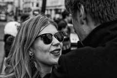 IMG_1605-Edit - beautiful blonde girl, ray bans, talking romantically (roger_thelwell) Tags: life street city uk winter portrait england people urban bw white black streets cold london lamp monochrome westminster beauty hat rain leather mobile umbrella hair bag walking real photography mono chat shiny phone traffic post natural photos britain circus cigarette candid cab taxi great over sac hats cell photographic smoking lamppost photographs oxford conversation shiney talking shoulder handbag stud speak speaking studs commuters scak beautifulblondegirlraybanstalkingromantically