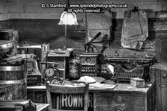 Old office in mono (splendid_photography_UK) Tags: blackandwhite mono chaos desk railway gaslamp britishrail clutter gaslight photomatix railwayoffice parceloffice