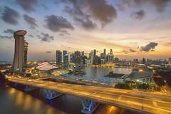 High Hopes (Mabmy) Tags: city bridge sunset sky clouds lumix flyer singapore stadium floating olympus casino esplanade cbd helix ultrawide mbs em1 7mm