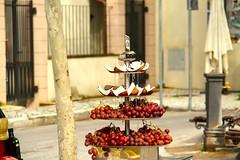 Street fruit seller, Pisa, Tuscany, Italy. (SETIANI LEON) Tags: voyage street italy fruits fruit canon eos italian italia ngc pisa coco journey tuscany 7d rue toscane rues seller raisin italie pise vendeur flickrtravelaward