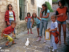 Budva - en ny hundehvalp. (Bernt Nielsen) Tags: people pet film analog puppy children 2006 montenegro budva
