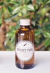 Rocket Fuel (35mm) (jcbkk1956) Tags: green film coffee leaves analog 35mm thailand bottle dof bokeh bangkok manual rocketfuel carlzeiss kodacolor200 thonglo contaxrts 45mmf28 rocketxcafe