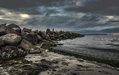 On The Jetty (jeanmarie shelton) Tags: jeanmarieshelton jeanmarie sky clouds cloudy ocean jetty sunset beach sand rocks nikon nature tide serene sea man outdoors edmondswa seascape