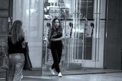 uscita dal negozio (eliobuscemi) Tags: negozio vetrina girl