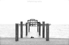 Brighton - Solitude and Decay (Sandrine Vivs-Rotger photography) Tags: uk beach architecture pier brighton solitude alone decay horizon gravel