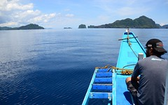 Sailing into the El Nido Bay, Palawan, Philippines (Aditi Patnaik) Tags: blue water bacuit el nido palawan philippines south china sea boat bangka looking out island