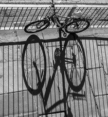 BRY_20160224_IMG_8126_ (stephenbryan825) Tags: bicycle liverpool shadows graphic pavement wheels abstracts railings backlighting selects