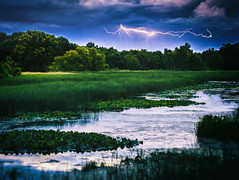 Crackle! (Bobby Palosaari) Tags: connorbayou atmosphere bayou blue flash landscape lightning natural reflection sky storm water wetland