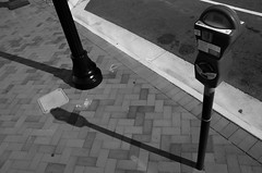 It Was Only a Matter of Time (SteveNakatani) Tags: blackandwhite norfolk street urban downtown time sidewalk brick pavement parking meter shadows sun dial
