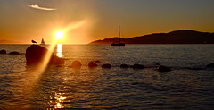 Sunset (kristinkarmella) Tags: beach sunset rock boat water sillouette vancouver mountain vancity