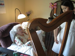 Sophia explaining the harp to Betty (Pictures by Ann) Tags: music holiday singing time song july betty musical help volunteering sing service therapy harp volunteer 4thofjuly fourth homeschool communityservice sophia seniors homeschooling helping donate nursinghome seniorcitizens donating musictherapy harpmusic