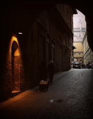 Yellow Door (damar47) Tags: street light shadow people canon vintage walking eos lowlight shadows arc citylife streetphotography medieval ombre bologna walls oldtown medievale citycentre penombra