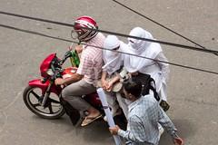 H504_3505 (bandashing) Tags: motorbike ride white hijab burkah niqab passengers wires road street girls walk sylhet manchester england bangladesh bandashing aoa socialdocumentary akhtarowaisahmed