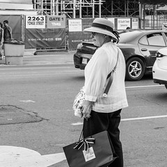 Bringing home the Saks, uptown (PJMixer) Tags: 52weekproject bw fuji summer toronto candid people street uptown