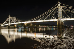 A Tale of Two Bridges (Torsten Reimer) Tags: uk longexposure bridge england sky london water thames night reflections river boats lights europa europe mud nacht unitedkingdom gb lowtide brcke fluss battersea wandsworth themse albertbridge langzeitbelichtung reflektionen
